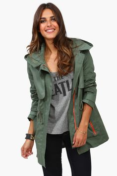 Olive green jacket, grey Beatle t shirt and black stretch pants