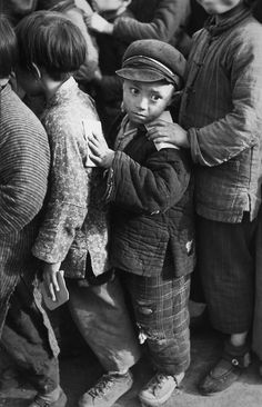 "Bid now on ""Les petits professeurs"" lining up for rice, Shanghai, China by Henri Cartier-Bresson. View a wide Variety of artworks by Henri Cartier-Bresson, now available for sale on artnet Auctions. Henri Cartier Bresson, Candid Photography, Vintage Photography, Fine Art Photography, Street Photography, Urban Photography, Robert Doisneau, Edward Weston, Magnum Photos"