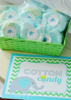 Cotton Candy  A Bright and Fun First Birthday!  Frosted Events--  The cutest little boy birthday party in aqua blue, yellow and green.  Chevron and dot patterns, a gorgeous dessert table, cute elephant party hat and party favors, elephant decorated cookies and cupcakes, a popcorn bar and lots more!   #firstbirthday #boysfirstbirthday #babyelephant #blueandgreen #blueandyellow #kidsparty #desserttable