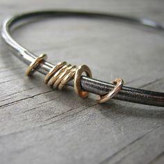 14k Gold and Sterling Spinning Bangle Bracelet by onegarnetgirl, $183.00