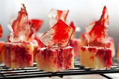 Blood Splattered Petit Fours - These fleshy looking petit fours are perfect for sharing during a horror movie marathon or as part of the creepiest afternoon tea imaginable. They start with a frozen pound cake, so all your effort goes into the fun part, which is decorating (and devouring).