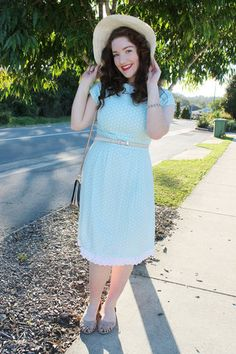 Maria is stunning in sky blue polka dots and a summery hat. Click to shop similar pieces! #stylegallery