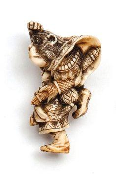 A Japanese ivory netsuke of a monkey dressed as a Samurai, Meiji period (1868-1912), 6 cm high