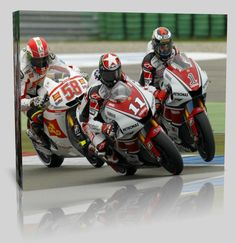 Large Printed & Stretched Hanging Canvas featuring Ben Spies #11 (USA) on his 500cc Yamaha, leading from Jorge Lorenzo #01 (ESP) & the late, great Marco Simoncelli #58 (ITA).  Simoncelli's untimely death in late 2011 makes this a truly collectable shot.    To order this exact  image, as a photo, large canvas prints or on any other personalised collectable products or printable items of Home Décor, visit our 'Legends of the Sport' store online!