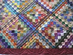Miriam's Quilts: Scrappy quilt - Love the quilting on this trip around the world quilt!