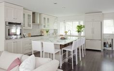 LOLV EP2042 Love the bone cabinets w/white Quartz...wish you could also see the distressed table/lucite chairs