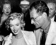 Marilyn Monroe and Arthur Miller upon their arrival at Idlewild Airport in London, 1956.