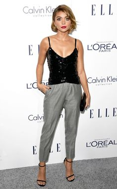 Sarah Hyland from 2015 Elle Women in Hollywood Awards  The Modern Family star sparkles in a black top while revealing a healthy dose of cleavage.