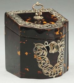 Rare Century Tortoise Shell Tea Caddy With sterling overlay.