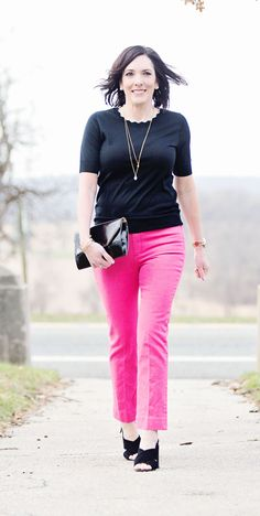 22 Days of Spring Fashion | Spring Outfit | Fashion for Women Over 40 | Jo-Lynne Shane wearing Rag & Bone Bull Pink high waist ankle cigarette leg jeans with black Ann Taylor scalloped short sleeve sweater and KSNY Christopher block heel sandals.