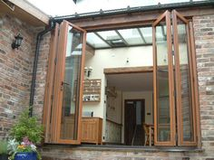 outswing french door on brick house images | Opened Folding Glazed Door For Brick Home Wall Design With Inside View ...