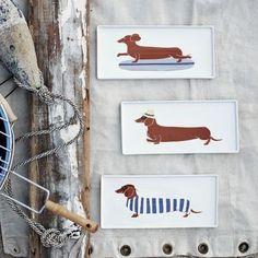 Claudia Pearson Dog Plates - $16.00»  Sun-bathing dachshunds, swimming dachshunds and surfing dachshunds — oh my!