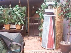 Light house , made from old barn wood , old light shade fixture , old bottle with 100 strand solar lights in it , oil drain pan , ceiling fan spinner , so it actually spins at the top , old trash can lid and at the bottom  an old bicycle tire then painted red/white and blue  , its awesome looking