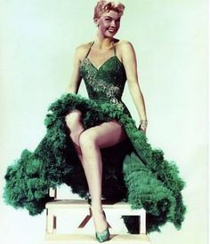 Doris Day who's looking fabulous in her very fancy and festive ball gown wearin of the green