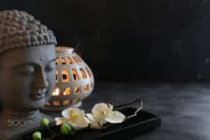 buddah witn candle and towel spa concept - buddah witn candle and towel spa concept