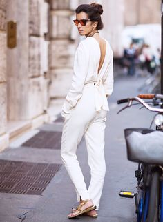 This white one-piece pantsuit is INSANE amazing