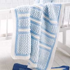 Small Wonders -- Baby Bubble Wrap Design by Shari White This precious baby afghan was a prizewinner in the 2010 Crochet Guild of America Design Contest. With its plush bubble stitches and interesting design, it's easy to see why. Download this pattern  Please note: To view or download, you will need Adobe® Reader®
