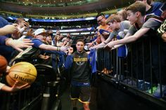Klay Thompson of the Golden State Warriors high fives fans prior to the game against the New York Knicks on February 26 2018 at Madison Square Garden...