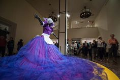 Travis Young/KANSAN Spectators crowd around a sculpture titled Sophie-Ntombikayis by Mary Sibande Thursday night Sept. 27 at the Spencer Museum of Art. The Museum held held an event to celebrate the exhibitions on view this fall. It was part of the Fall Art Walk.