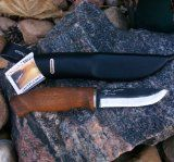 Puukko Knife known for being the worlds sharpest hand crafted knife  Excellent hunting knife with a handmade birch wood handle  These knifes make an excellent gift,read more