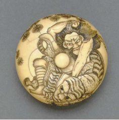 Ivory Manju Netsuke, sunken relief with the warrior Busho about to kill a tiger. EDO-MEIJI PERIOD (19TH CENTURY), SIGNED MORIMASA AND WITH KAO (CURSIVE MONOGRAM).