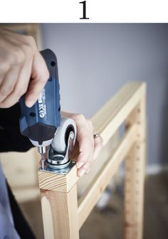 Attaching castors to the bottom of your IVAR shelf lets you move it easier.