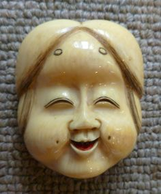 Okame Mask in antique ivory