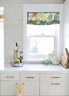 "Backsplash.  (I can't find these large marble hexagons, but I have found an opal marble 2"" hexagon mosaic that is affordable.)"
