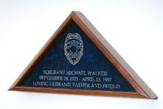 The finest law enforcement burial flag case anywhere, bar none.  Each our flag display cases are constructed from the highest quality solid oak, walnut, cherry, or Mahogany.  The double strength glass is laser engraved your choice of Law Enforcement badges.  Each Badge can be personalized with the individuals Badge Number and Department name, making this the most fitting heirloom to honor these special individuals who protect us everyday.