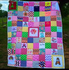Monogrammed items from birth to first year on a quilt. Great idea!