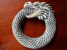 Ouroboros by ~Ljotunnr on deviantART  Snake devouring itself, an ancient but still current symbol of cyclicality. Jörmungandr in Norse mythology. (Made of basswood) (200 €)