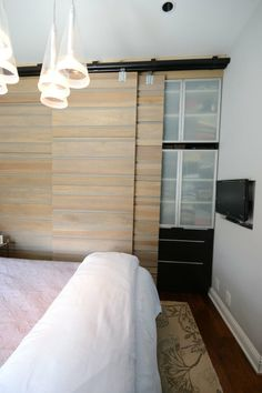 closet organizer with sliding wall... (apartmenttherapy)