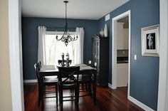 painted wall + square dining table + tall chairs + hutch + simple drapes + art