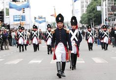 Argentine Army soldiers dressed in the historical uniforms of the 1807 Spanish Army grenadiers marching down Avenida Roque Sáenz Peña in Buenos Aires at the 2010 Argentine Bicentennial Independence Day Parade.