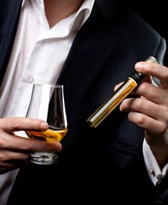 Man Holding Tasting Collection Whisky Tube and Tasting Glass