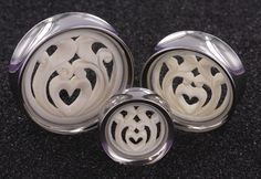 These beautiful Heart n Vines Bone Synthesis Plugs merge bone and steel into one sweet design. The bone insert has a heart and vines carved into it, and it's set in a hand-polished double flare stainless steel tunnel. Available in sizes 18mm-34mm. Prices start at $24.99 for 1 or $21.99 each when you buy a pair, but prices vary by size.