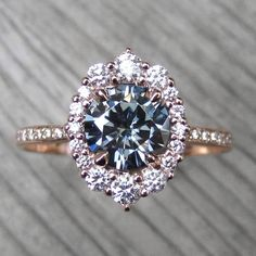 1.5ct Charles & Colvard Grey moissanite rose gold halo ring with a diamond halo and diamond band