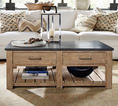I like this style Parker Reclaimed Wood Coffee Table.  Made with kiln-dried reclaimed fir