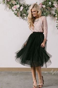 No closet is complete without a tulle midi skirt! This pretty piece has an elastic waist for a better fit, and layers of soft and delicate tulle! We love having a black tulle midi skirt in our closets More