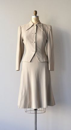 Vintage 1950s putty wool two-piece suit with pointed lapel, fitted jacket, fabric buttons and flared skirt.  ✂-----Measurements  fits like: small  -