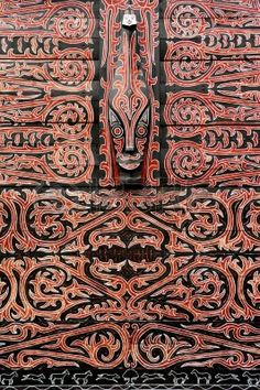 Indonesia, Sumatra:detail of a wood typical painting and carved  decoration of an Indonesian house photo