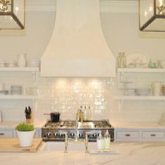 GORGEOUS white subway tile and open shelving