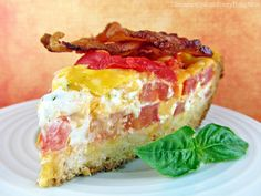 "Tomato Cheddar Pie - Make it Low Carb -  ""Layers of fresh tomatoes, cheddar cheese and a basil cream cheese blend make up the luxuriously rich filling...."" That got my attention!! One to turn into a Low Carb dish - sub the crust (or without) and for filling it calls for a bit of sugar..easy!"