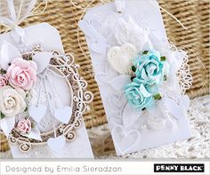 Their creations are both lovely and layered, elegant and cute, and we're so excited that today is… Today we begin with Emilia Sieradzan, AKA Lady E's trio of tags. White on white stenciling a…