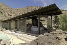 Frey House by Albert Frey. The house is wedged on a rock and built around it. https://www.quora.com/What-are-the-most-beautiful-modern-architectural-creations