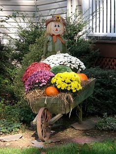"33 Gorgeous Garden Scarecrow Ideas - Why not take some basic household items or even ""trash"" and turn them into one-of-a-kind, beautiful garden art? Garden art, like all art, is often in . Fall Yard Decor, Fall Wagon Decor, Outside Halloween Decorations, Backyard Decorations, Wheelbarrow Planter, Garden Cart, Decoration Originale, Autumn Decorating, Autumn Garden"