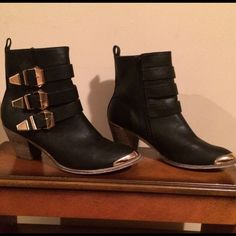 Size 8 Black & Gold Metal Trim Ankle Length Boot. Size 8 Black & Gold Metal Trim Ankle Length Boot. Perfect for the rain and stylish. Vinyl material-Man made material, so ok to get wet. Heel measures 2 1/2 inches. No issues. Bucco Shoes