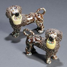 Pair of Porcelain Poodles with Baskets of Flowers, never seen them painted this way, but still like them.