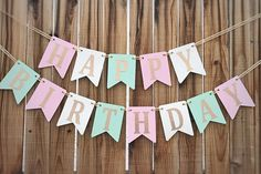Celebrate with a pink, cream, and mint Happy Birthday banner made with gold glitter letters and strung with gold ribbon! Dimensions: Each panel is 3.85 wide by 5 tall Letters are approximately 3 tall The banner pictured is textured with hearts; it can also be purchased without the