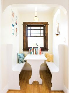 Your small-space inspiration is served: this slim little dining nook barely takes up any square footage at all.